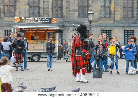 Amsterdam the Netherlands - October 03 2015: Male playing Scottish traditional pipes in historic city centre