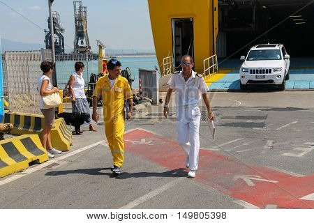 Piombino Italy - June 30 2015: Sailors of ferry boat Corsica Express at berth in Piombino seaport Italy