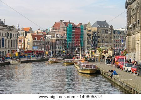 Amsterdam the Netherlands - October 03 2015: Tourist boats on the canal of Amsterdam