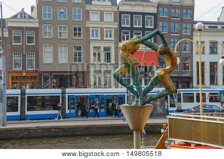 Amsterdam the Netherlands - October 03 2015: Sculpture of the young man and women in historic city centre