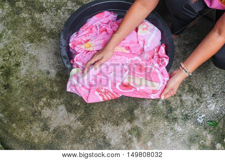 hand woman clothes work wash in sink black for clean Thailand style ancient