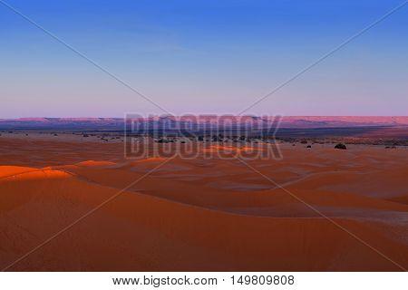 Sand dunes in Sahara desert on blue sky background, Morocco