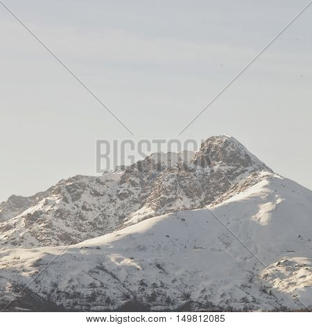 Top of a snowy mountain square image