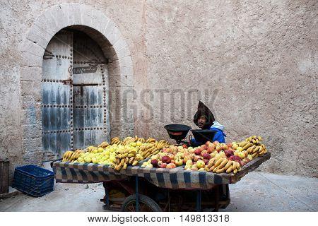 ESSAOUIRA, MOROCCO - JANUARY 14, 2014: Vendor poses for a photo in the souk in Essaouira, Morocco.
