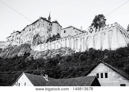 Cesky Sternberk is a Bohemian castle of the mid-13th century located within the village with the same name of the Central Bohemian region in Czech republic. Black and white photo. Travel destination.