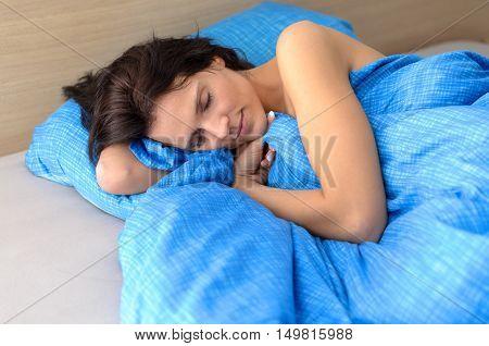Pretty Young Woman Enjoying A Relaxing Sleep