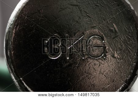Equipment for a workout. Heavy black metallic dumbbell weighting 3 kg and lying in a gym