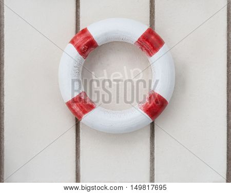 Wooden life buoy on wood with the word help