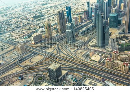 Aerial view of traffic on Sheikh Zayed Road highway interchange in Dubai downtown, United Arab Emirates.