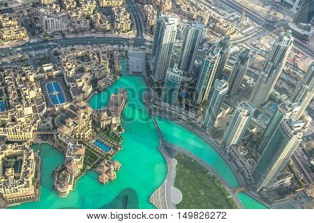 Aerial view of Dubai Fountain area, Burj Khalifa Lake and skyscrapers of Old Town Island in Dubai downtown, United Arab Emirates, from top.