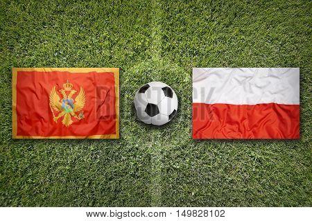 Montenegro vs. Poland flags on green soccer field, 3D illustration