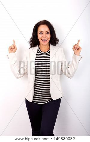 Portrait of smiling woman with fingers in air
