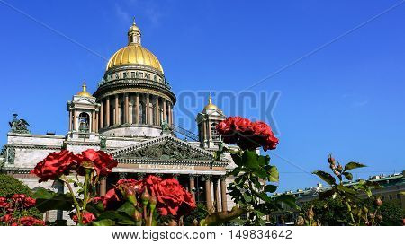 Saint Isaac Cathedral with roses in Saint-Petersburg, Russia.