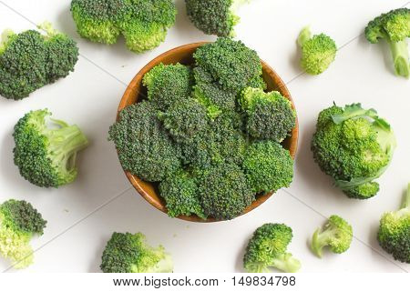 Broccoli into a bowl isolated in white background