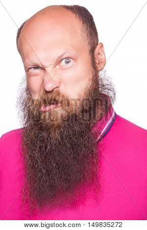 Portrait of a funny bald bearded man against a white background. isolated studio shot.