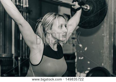 Female on weightlifting training, black and white image, horizontal