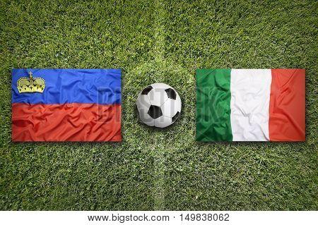 Liechtenstein vs. Italy flags on green soccer field, 3D illustration