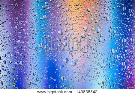 Abstract texture - Water drops on glass with blue and purple background