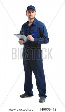 Young mechanic in uniform with a clipboard and pen, isolated on white