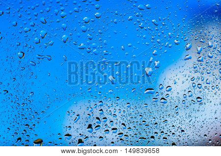 Abstract texture - Water drops on glass with blue background