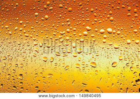 Abstract texture - Water drops on glass with orange background