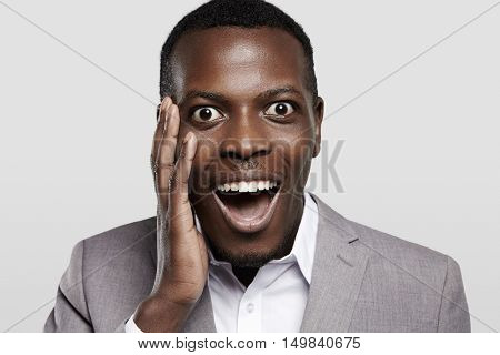 Happy And Amazed African Corporate Worker Dressed In Formal Wear Looking At Camera In Full Disbelief