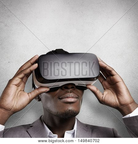 Technology And Entertainment. African Office Worker In Formal Wear, Experiencing Virtual Reality, We