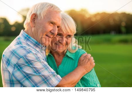 Senior man hugging woman. Smiling elderly couple outdoors. Best present life can give. You are my everything.