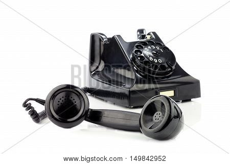 Old retro bakelite telephone. On a white background.