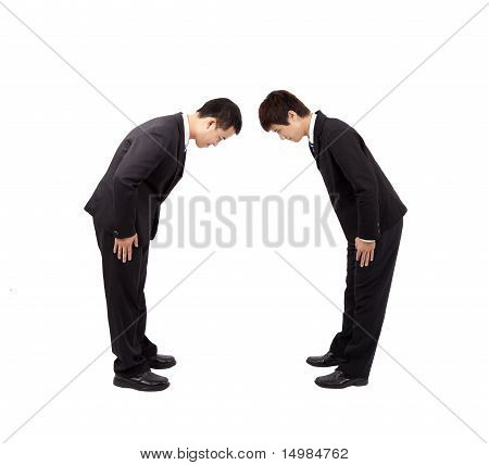 Two asian businessman with bow.Isolated with white background.