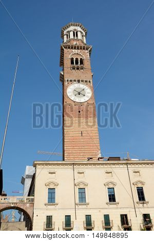 Verona Italy - September 3 2016: Torre dei Lamberti tower on Piazza Delle Erbe square in Verona Italy. Unidentified people visible.