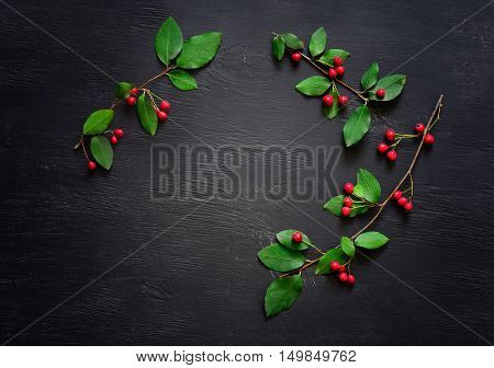 Christmas simple rustic dark background with a space for a greeting text flat lay