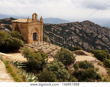 Spring day. March 28 2013. The Hiking trail in the mountains of Montserrat Sant Joan chapel
