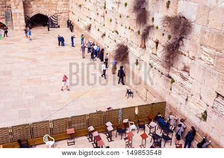 JERUSALEM, ISRAEL - MARCH 09, 2016: The area with tourists and pilgrims in front of the Western Wall in Jerusalem. Judaism. Israel.