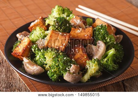 Vegetarian Stir Fry: Tofu With Broccoli, Mushrooms And Sesame Closeup. Horizontal