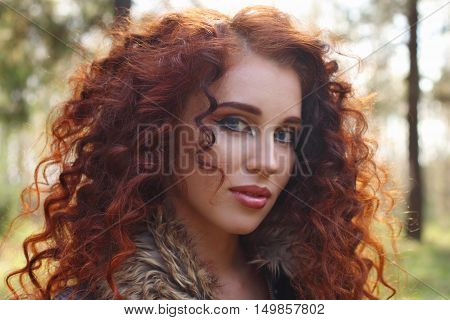 Beautiful girl in black brace poses in sunny autumn forest close up