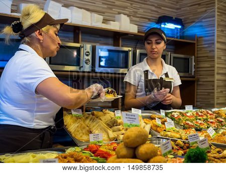 Alushta, Russia - June12, 2016: Workers in a cafe on the distribution of selected dishes are prepared to issue