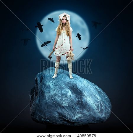 Bloodthirsty hammer girl against a night landscape.