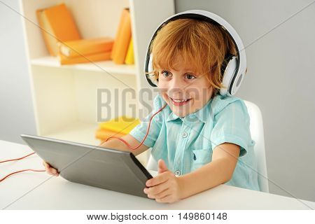 learning and next generation concept, adorable young boy listen to music