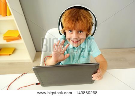 learning and next generation concept, little developer in headphones saying hello