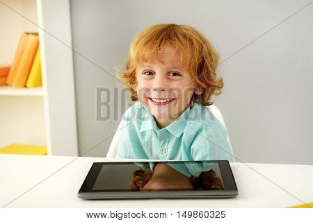 learning and next generation concept, intelligent young boy smiling in front of portable computer