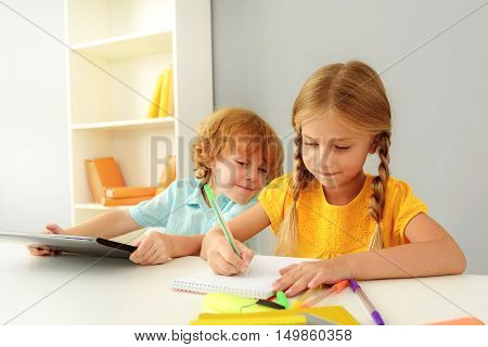 learning and next generation concept, little boy and girl sitting in elementary school