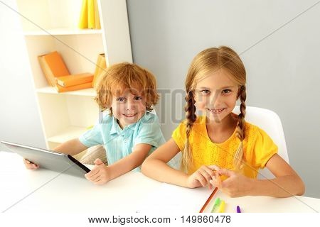 learning and next generation concept, little children smiling and looking into camera