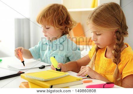 learning and next generation concept, selective focus on girl drawing and boy on the background
