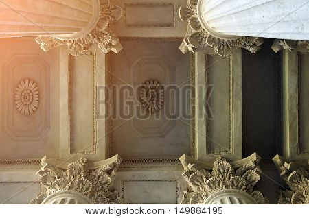 Architecture details of Kazan Cathedral colonnade and ceiling lit by soft sunshine in St Petersburg Russia. Architecture background. Closeup architecture view of St Petersburg landmark