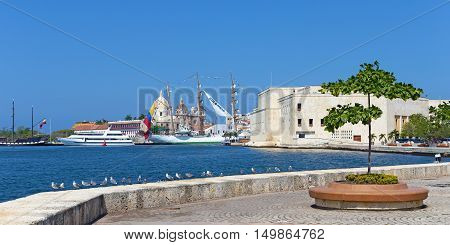 CARTAGENA COLOMBIA - DECEMBER 28 2015: The historic Colombian Tall Ship at pier in Cartagena Colombia on December 28 2015. The ship moored at the pier with city view on background.