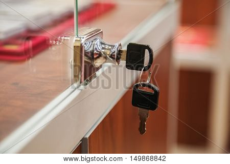 Key in showcase lock in the shop close-up shot