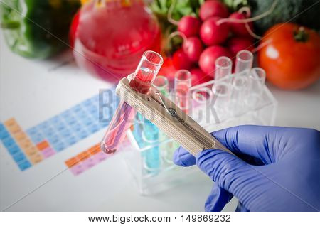 Analyst In Gloves Takes Test Tube. Genetically Modified Food Concept.