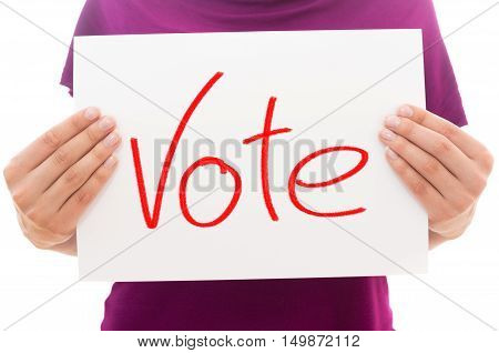 Girl holding white paper sheet with text Vote