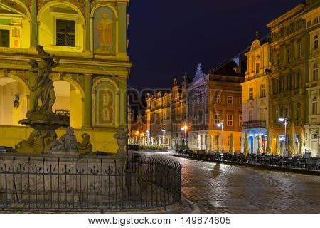 Poznan Poland - September 30 2016: Night photo of Poznan Old Town with Prozerpin's fountain beautifully decorated facade of the city hall and numerous highlighted townhouses.